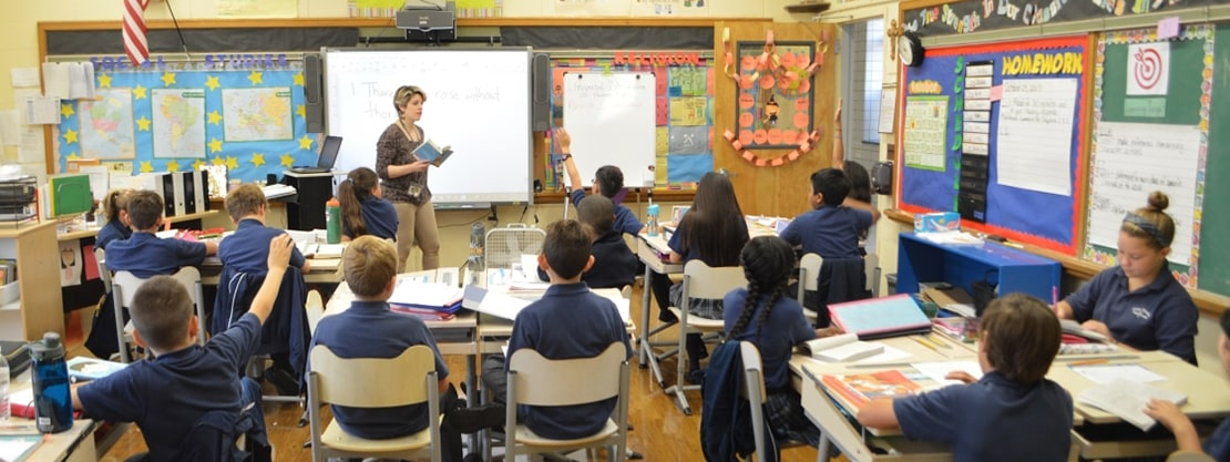 Divine Wisdom Catholic Academy students and teacher in classroom